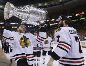 Chicago Blackhawks bearded right wing Patrick Kane hoists the Stanley Cup alongside fellow beardo defenseman Brent Seabrook after the Blackhawks beat the Boston Bruins 3-2 in Game 6 of the NHL hockey Stanley Cup Finals Monday, June 24, 2013, in Boston. (AP Photo/Elise Amendola)